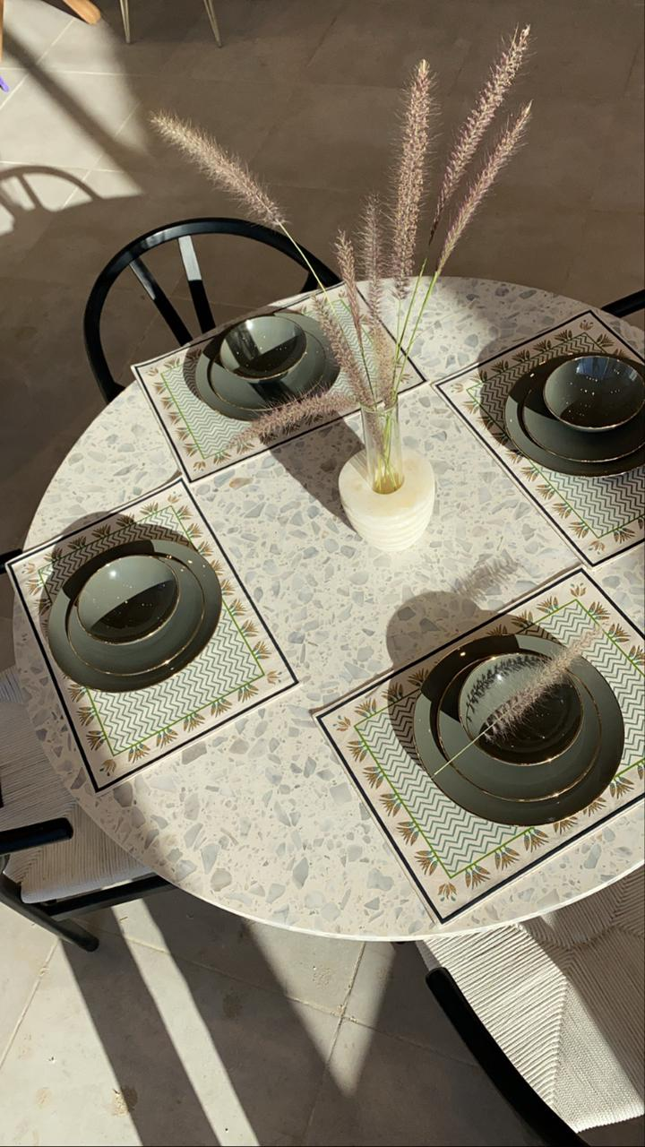 Trapeze Round Dining Table with Terrazzo Top